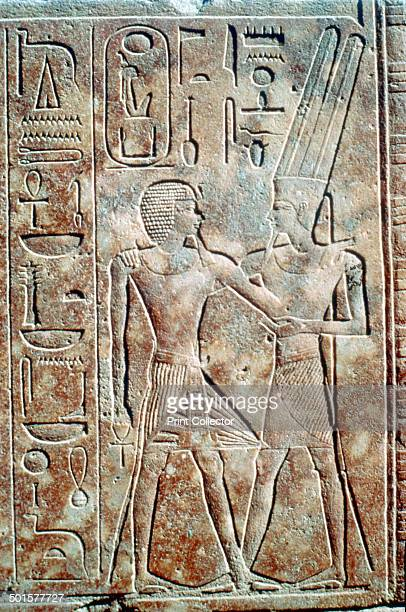 Relief of Queen Hatshepsut in male dress Temple of Amun Karnak Egypt c1500 BC The Queen in male dress with Pharaonic beard is embraced by AmunRa