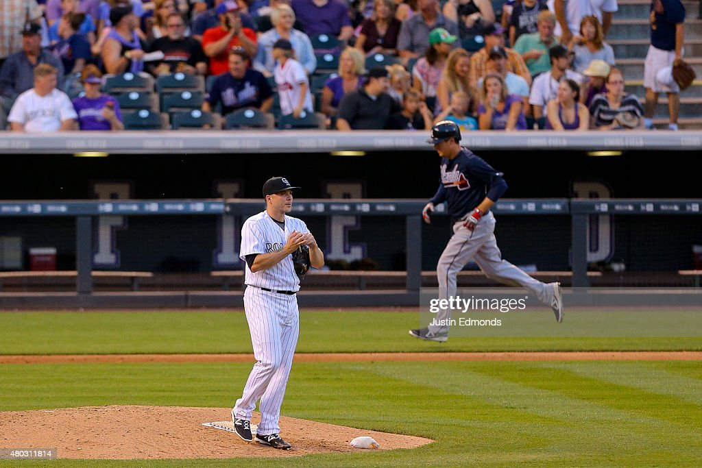 Relief pitcher <a gi-track='captionPersonalityLinkClicked' href=/galleries/search?phrase=Aaron+Laffey&family=editorial&specificpeople=4175149 ng-click='$event.stopPropagation()'>Aaron Laffey</a> #34 of the Colorado Rockies looks towards the scoreboard after giving up a three-run home run to <a gi-track='captionPersonalityLinkClicked' href=/galleries/search?phrase=Kelly+Johnson+-+Jugador+de+b%C3%A9isbol&family=editorial&specificpeople=4520789 ng-click='$event.stopPropagation()'>Kelly Johnson</a> #24 of the Atlanta Braves during the sixth inning at Coors Field on July 10, 2015 in Denver, Colorado.