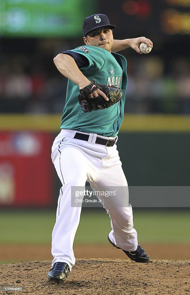 Relief pitcher <a gi-track='captionPersonalityLinkClicked' href=/galleries/search?phrase=Aaron+Laffey&family=editorial&specificpeople=4175149 ng-click='$event.stopPropagation()'>Aaron Laffey</a> #32 of the Seattle Mariners pitches against the Tampa Bay Rays at Safeco Field on July 29, 2011 in Seattle, Washington.