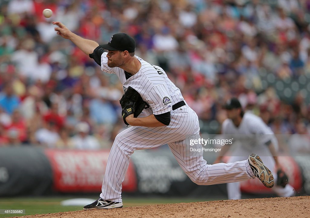 Relief pitcher Adam Ottavino #0 of the Colorado Rockies delivers against the St. Louis Cardinals at Coors Field on June 25, 2014 in Denver, Colorado. Ottavino collected the loss as the Cardinals defeated the Rockies 9-6.