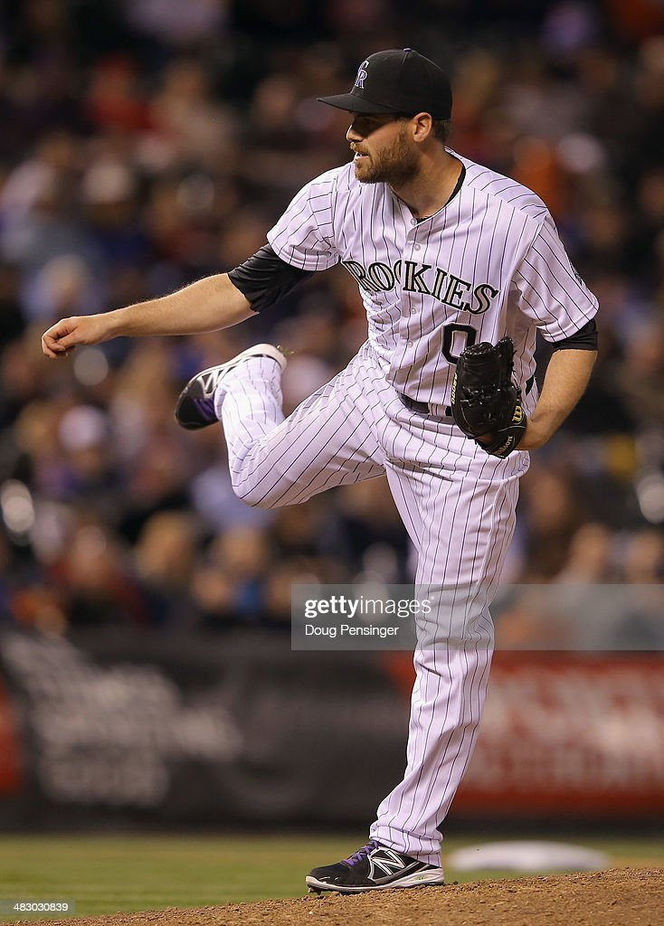 Relief pitcher Adam Ottavino #0 of the Colorado Rockies delivers against the Arizona Diamondbacks at Coors Field on April 5, 2014 in Denver, Colorado. The Rockies defeated the Diamondbacks 9-4.