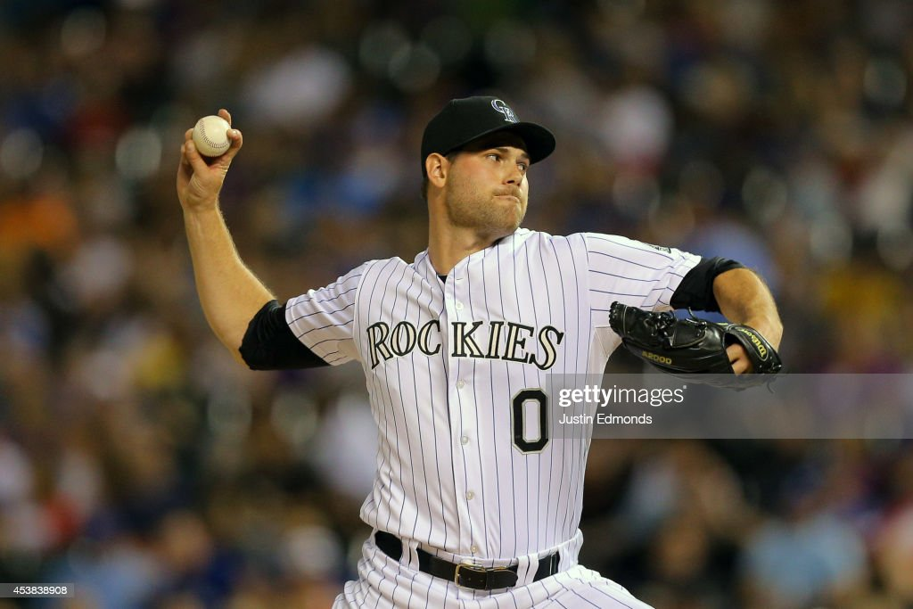 Relief pitcher Adam Ottavino #0 of the Colorado Rockies delivers to home plate during the seventh inning against the Kansas City Royals at Coors Field on August 19, 2014 in Denver, Colorado.