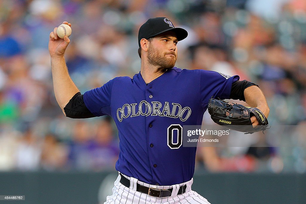 Relief pitcher Adam Ottavino #0 of the Colorado Rockies delivers to home plate during the eighth inning against the San Francisco Giants at Coors Field on September 1, 2014 in Denver, Colorado. The Rockies defeated the Giants 10-9 on a walk-off single by Charlie Blackmon.