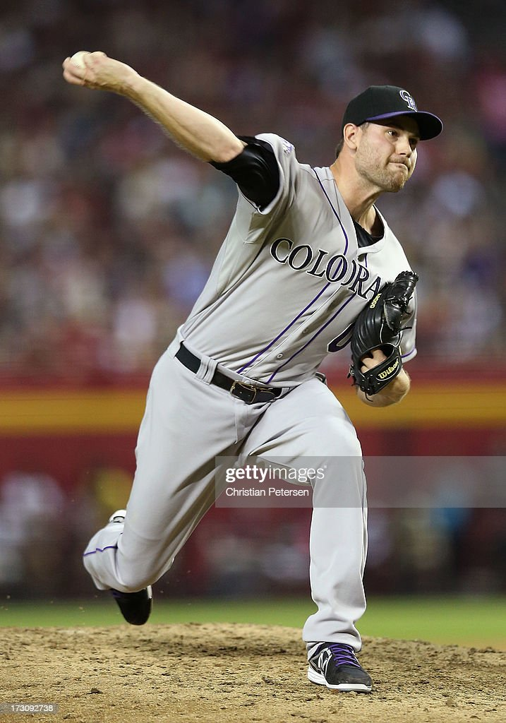Relief pitcher Adam Ottavino #0 of the Colorado Rockies pitches against the Arizona Diamondbacks during the MLB game at Chase Field on July 5, 2013 in Phoenix, Arizona. The Diamondbacks defeated the Rockies 5-0.