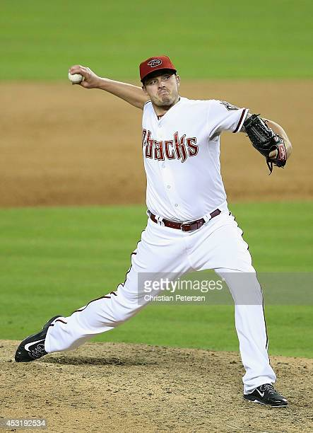 Relief pitcher Addison Reed of the Arizona Diamondbacks pitches against the Chicago Cubs during the MLB game at Chase Field on July 18 2014 in...
