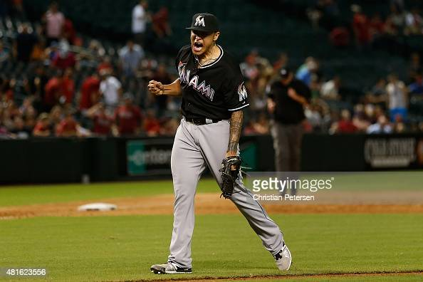 Relief pitcher AJ Ramos of the Miami Marlins celebrates after defeating the Arizona Diamondbacks 53 in the MLB game at Chase Field on July 22 2015 in...