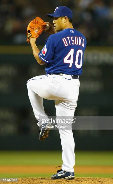Relief pitcher Akinori Otsuka of the Texas Rangers pitches against the Oakland Athletics during the MLB game at Ameriquest Field on April 25 2006 in...