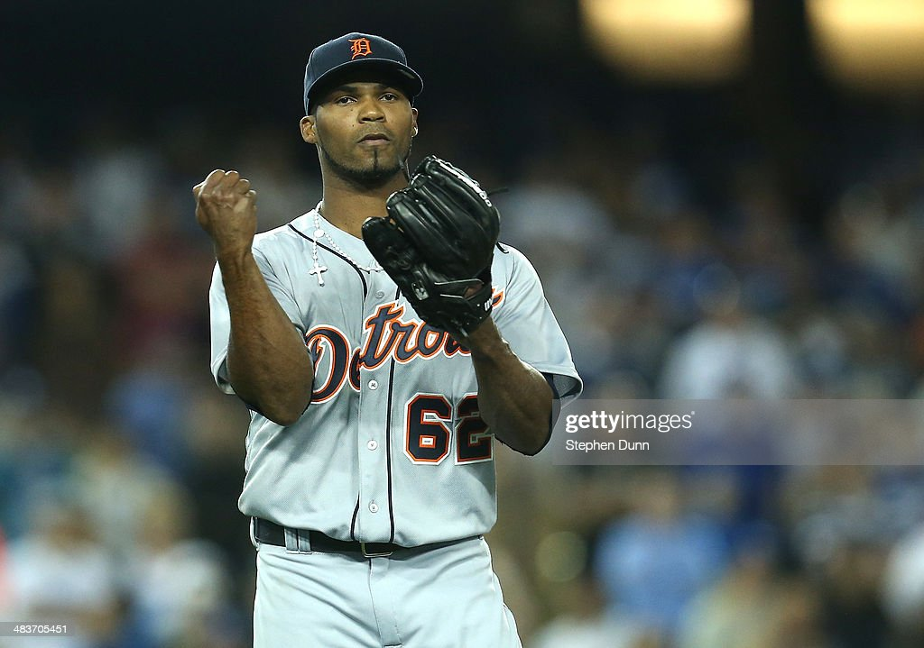 Relief pitcher <a gi-track='captionPersonalityLinkClicked' href=/galleries/search?phrase=Al+Alburquerque&family=editorial&specificpeople=6829031 ng-click='$event.stopPropagation()'>Al Alburquerque</a> #62 of the Detroit Tigers celebrates after getting thefinal out and picking up the save against the Los Angeles Dodgers at Dodger Stadium on April 9, 2014 in Los Angeles, California. The Tigers won 7-6 in ten innings.