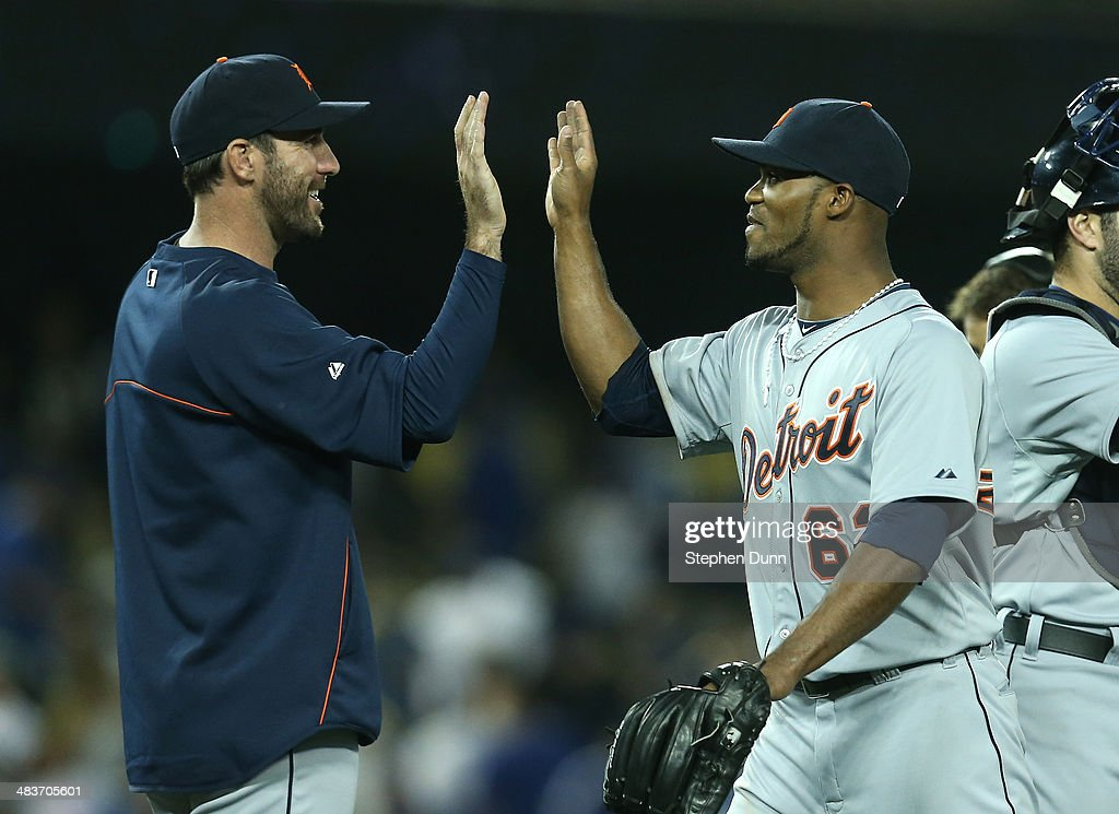 Relief pitcher <a gi-track='captionPersonalityLinkClicked' href=/galleries/search?phrase=Al+Alburquerque&family=editorial&specificpeople=6829031 ng-click='$event.stopPropagation()'>Al Alburquerque</a> #62 of the Detroit Tigers celebrates with <a gi-track='captionPersonalityLinkClicked' href=/galleries/search?phrase=Justin+Verlander&family=editorial&specificpeople=556723 ng-click='$event.stopPropagation()'>Justin Verlander</a> #35 after getting the final out and picking up the save against the Los Angeles Dodgers at Dodger Stadium on April 9, 2014 in Los Angeles, California. The Tigers won 7-6 in ten innings.