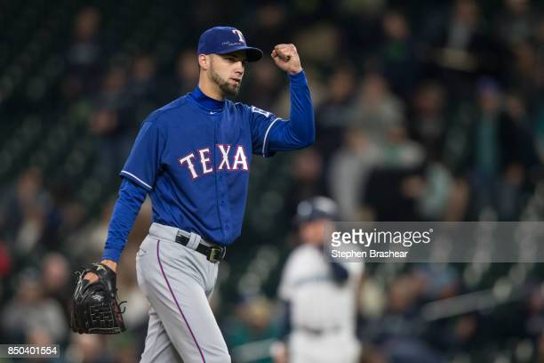 Relief pitcher Alex Claudio of the Texas Rangers pumps his fist after getting the save against the Seattle Mariners at Safeco Field on September 20...