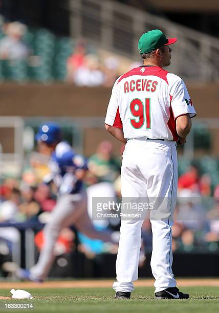 Relief pitcher Alfredo Aceves of Mexico reacts after giving up a tworun home run to Drew Butera of Italy during the fourth inning of the World...