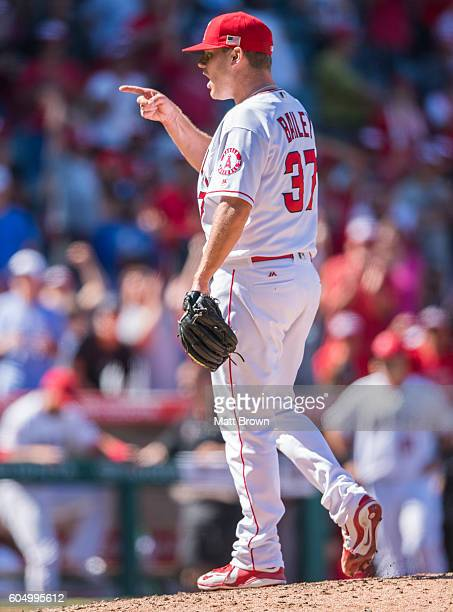 Relief pitcher Andrew Bailey of the Los Angeles Angels of Anaheim celebrates after throwing a strikeout for the final out in the ninth inning of a 32...