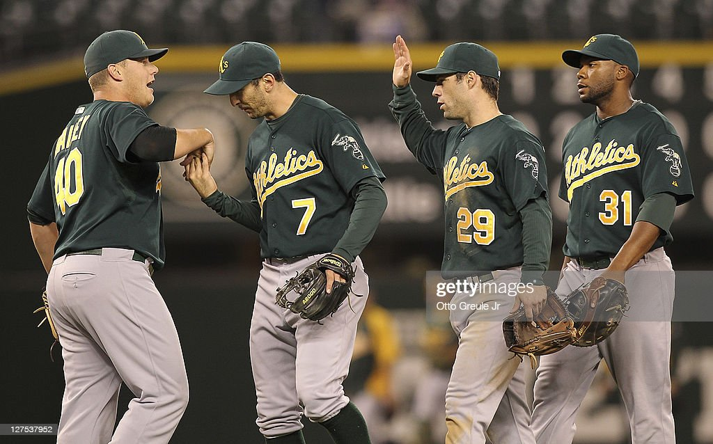 Relief pitcher Andrew Bailey #40 of the Oakland Athletics is congratulated by <a gi-track='captionPersonalityLinkClicked' href=/galleries/search?phrase=Adam+Rosales&family=editorial&specificpeople=4921731 ng-click='$event.stopPropagation()'>Adam Rosales</a> #7, <a gi-track='captionPersonalityLinkClicked' href=/galleries/search?phrase=Scott+Sizemore&family=editorial&specificpeople=4959084 ng-click='$event.stopPropagation()'>Scott Sizemore</a> #29, and <a gi-track='captionPersonalityLinkClicked' href=/galleries/search?phrase=Brandon+Allen+-+Baseball+Player&family=editorial&specificpeople=2238262 ng-click='$event.stopPropagation()'>Brandon Allen</a> #31 after defeating the Seattle Mariners 2-0 at Safeco Field on September 28, 2011 in Seattle, Washington.