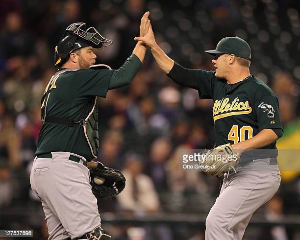 Relief pitcher Andrew Bailey of the Oakland Athletics is congratulated by catcher Landon Powell after defeating the Seattle Mariners 20 at Safeco...