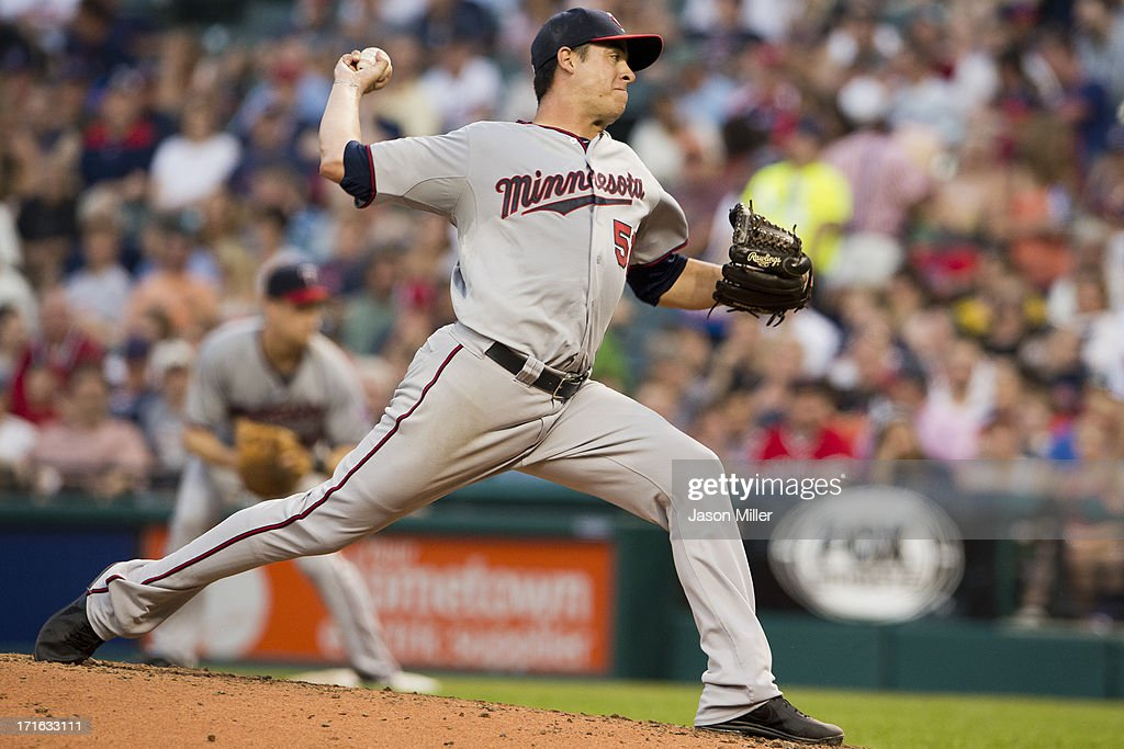 Relief pitcher <a gi-track='captionPersonalityLinkClicked' href=/galleries/search?phrase=Anthony+Swarzak&family=editorial&specificpeople=5758737 ng-click='$event.stopPropagation()'>Anthony Swarzak</a> #51 of the Minnesota Twins pitches during the third inning against the Cleveland Indians at Progressive Field on June 22, 2013 in Cleveland, Ohio.