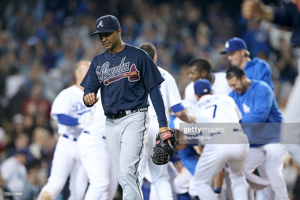 Relief pitcher <a gi-track='captionPersonalityLinkClicked' href=/galleries/search?phrase=Anthony+Varvaro&family=editorial&specificpeople=6778043 ng-click='$event.stopPropagation()'>Anthony Varvaro</a> #38 of the Atlanta Braves walks off the field after allowing the winning run with a wild pitch in the 10th inning as the Los Angeles Dodgers at Dodger Stadium on June 7, 2013 in Los Angeles, California. The Dodgers won 2-1 in 10 innings.