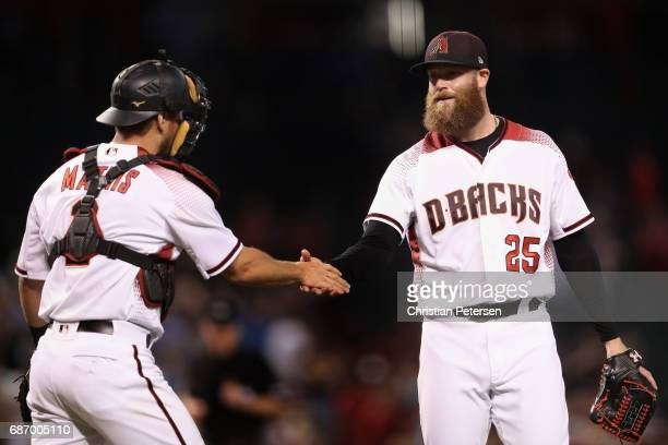 Relief pitcher Archie Bradley of the Arizona Diamondbacks celebrates with catcher Jeff Mathis after defeating the Chicago White Sox 51 in the MLB...