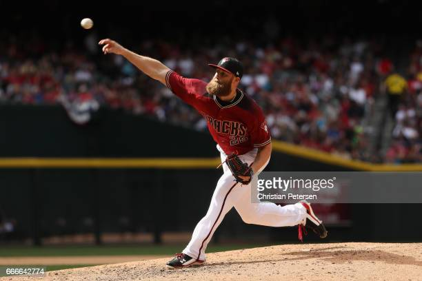 Relief pitcher Archie Bradley of the Arizona Diamondbacks pitches against the Cleveland Indians during the seventh inning of the MLB game at Chase...