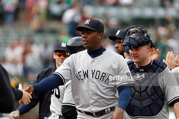 Relief pitcher Aroldis Chapman and catcher Brian McCann of the New York Yankees are greeted by teammates after defeating the the Oakland Athletics 54...