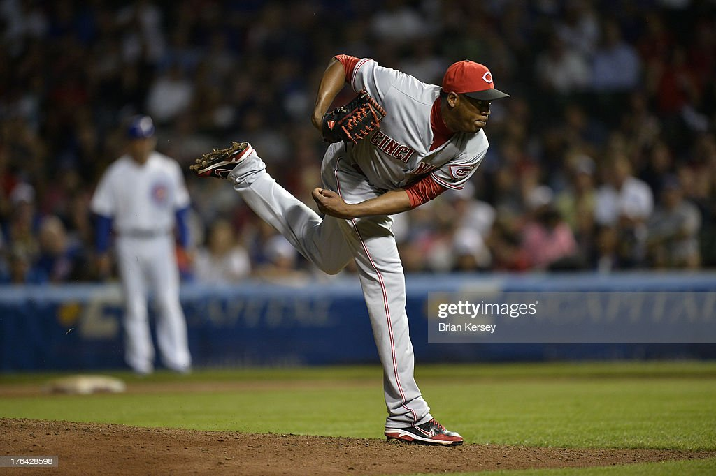 Relief pitcher <a gi-track='captionPersonalityLinkClicked' href=/galleries/search?phrase=Aroldis+Chapman&family=editorial&specificpeople=5753195 ng-click='$event.stopPropagation()'>Aroldis Chapman</a> #54 of the Cincinnati Reds delivers during the ninth inning against the Chicago Cubs at Wrigley Field on August 12, 2013 in Chicago, Illinois. The Reds defeated the Cubs 2-0.