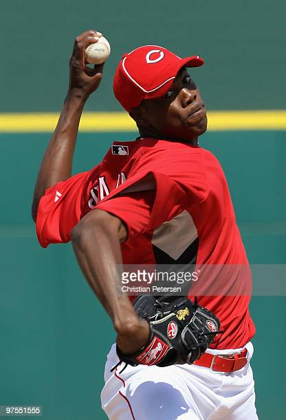 Relief pitcher Aroldis Chapman of the Cincinnati Reds pitches against the Kansas City Royals during the MLB spring training game at Goodyear Ballpark...