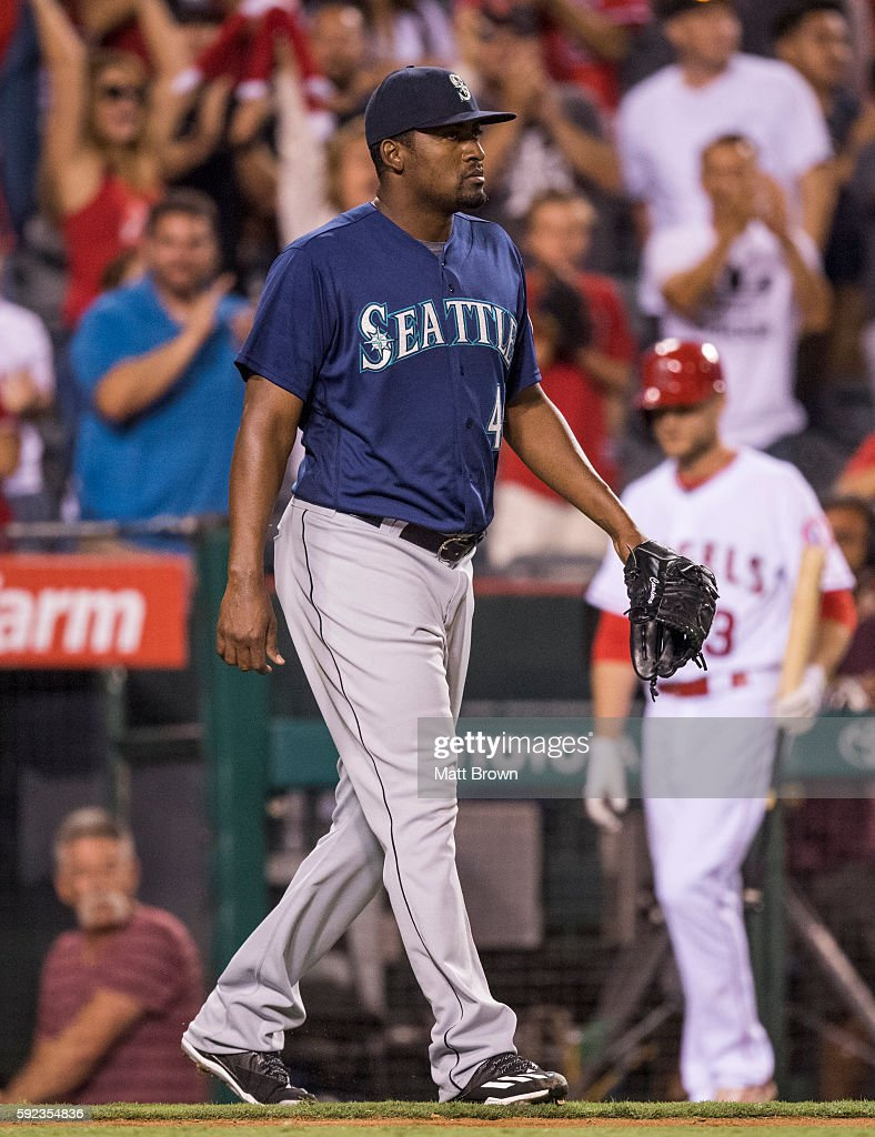 Relief pitcher Arquimedes Caminero of the Seattle Mariners reacts after allowing a goahead RBI triple to Cliff Pennington of the Los Angeles Angels...