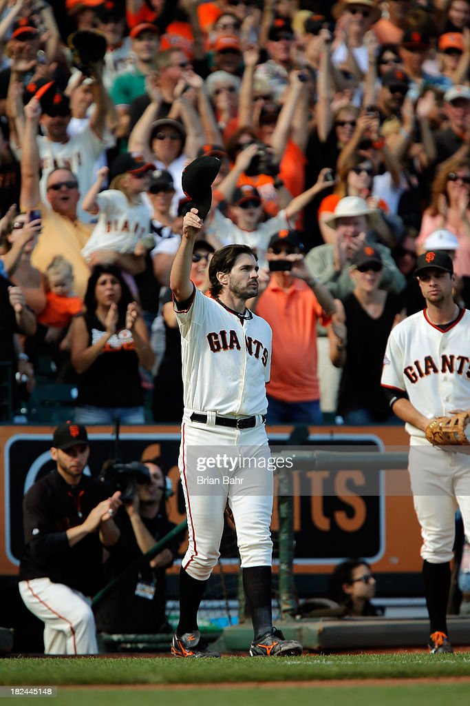 Relief pitcher <a gi-track='captionPersonalityLinkClicked' href=/galleries/search?phrase=Barry+Zito&family=editorial&specificpeople=202943 ng-click='$event.stopPropagation()'>Barry Zito</a> #75 of the San Francisco Giants gets a standing ovation as he leaves the field in the eighth inning at AT&T Park on September 29, 2013 in San Francisco, California. Zito has indicated this will be his last season as a Giant. The Giants won 7-6 with a walk-off RBI single in the 9th inning.