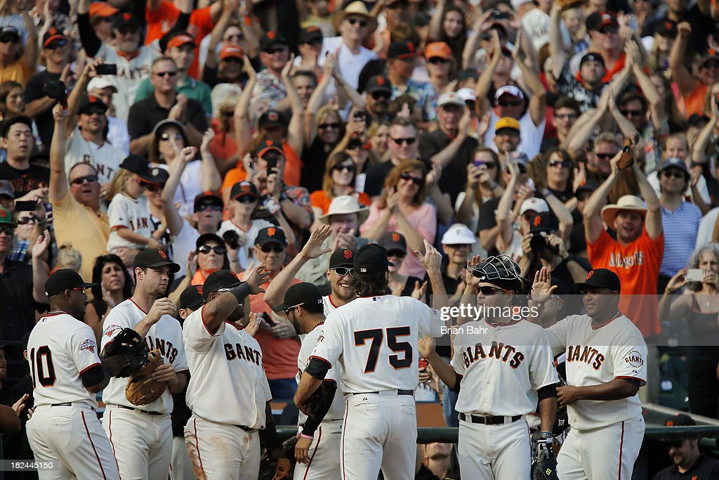 Relief pitcher <a gi-track='captionPersonalityLinkClicked' href=/galleries/search?phrase=Barry+Zito&family=editorial&specificpeople=202943 ng-click='$event.stopPropagation()'>Barry Zito</a> #75 of the San Francisco Giants gets a standing ovation as he leaves the field in the eighth inning at AT&T Park on September 29, 2013 in San Francisco, California. Zito has indicated this was his last season as a Giant. The Giants won 7-6 with a walk-off RBI single in the 9th inning.