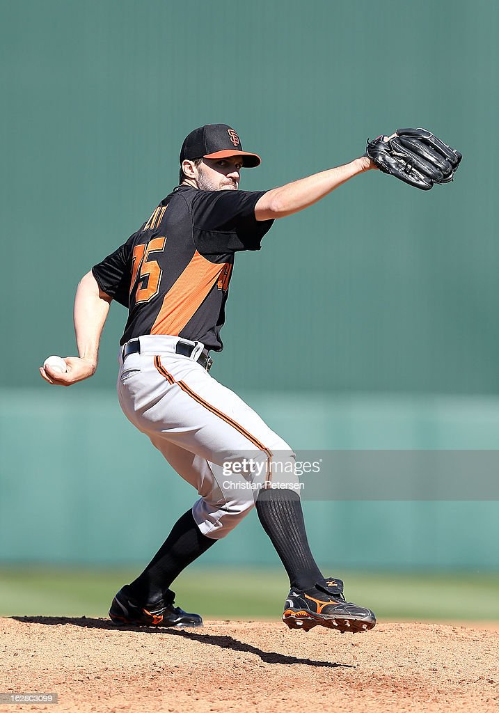 Relief pitcher <a gi-track='captionPersonalityLinkClicked' href=/galleries/search?phrase=Barry+Zito&family=editorial&specificpeople=202943 ng-click='$event.stopPropagation()'>Barry Zito</a> #75 of the San Francisco Giants pitches against the Los Angeles Angels during the spring training game at Tempe Diablo Stadium on February 27, 2013 in Tempe, Arizona.