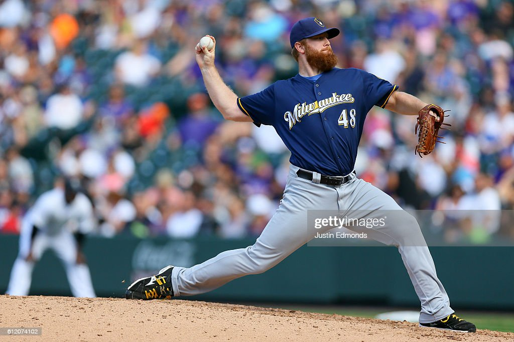 Relief pitcher Blaine Boyer #48 of the Milwaukee Brewers delivers to home plate during the seventh inning against the Colorado Rockies at Coors Field on October 2, 2016 in Denver, Colorado.