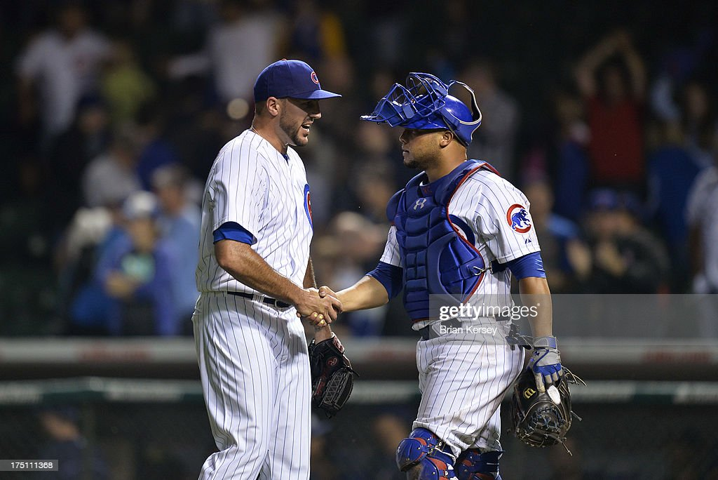 Relief pitcher Blake Parker #50 of the Chicago Cubs and catcher <a gi-track='captionPersonalityLinkClicked' href=/galleries/search?phrase=Welington+Castillo&family=editorial&specificpeople=4959193 ng-click='$event.stopPropagation()'>Welington Castillo</a> #53 shake hands after defeating the Milwaukee Brewers at Wrigley Field on July 31, 2013 in Chicago, Illinois. The Cubs defeated the Brewers 6-1.