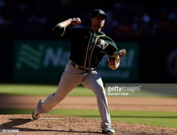 Relief pitcher Blake Treinen of the Oakland Athletics throws during the ninth inning of a baseball game against the Texas Rangers at Globe Life Park...