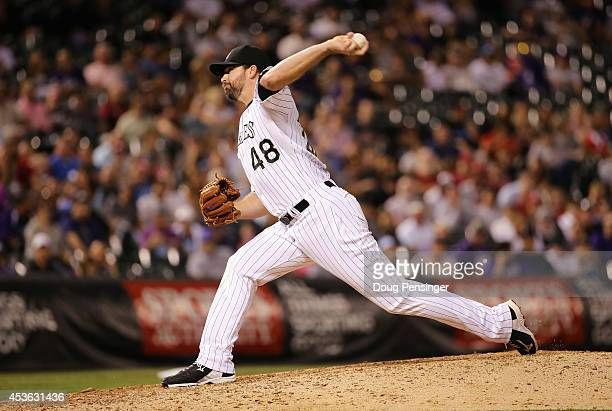 Relief pitcher Boone Logan of the Colorado Rockies delivers against the Cincinnati Reds at Coors Field on August 14 2014 in Denver Colorado The...