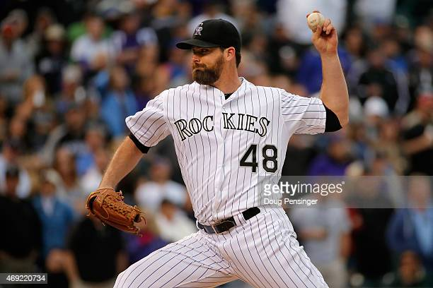 Relief pitcher Boone Logan of the Colorado Rockies delivers against the Chicago Cubs during the Rockies home opener at Coors Field on April 10 2015...