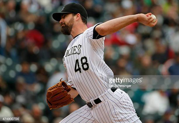 Relief pitcher Boone Logan of the Colorado Rockies delivers against the Philadelphia Phillies at Coors Field on May 21 2015 in Denver Colorado The...