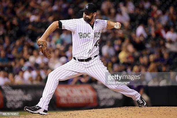 Relief pitcher Boone Logan of the Colorado Rockies delivers against the Seattle Mariners during interleague play at Coors Field on August 4 2015 in...