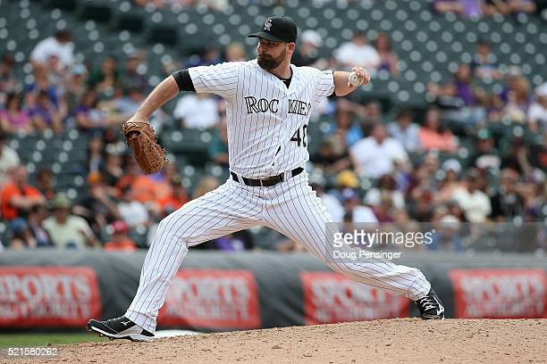 Relief pitcher Boone Logan of the Colorado Rockies delivers against the San Francisco Giants at Coors Field on April 14 2016 in Denver Colorado The...