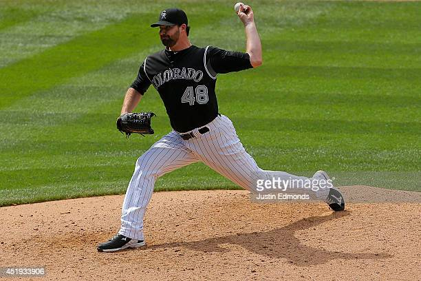 Relief pitcher Boone Logan of the Colorado Rockies delivers to home plate during the eighth inning against the San Diego Padres at Coors Field on...