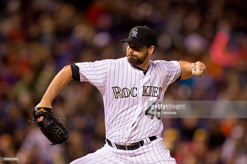 Relief pitcher <a gi-track='captionPersonalityLinkClicked' href=/galleries/search?phrase=Boone+Logan&family=editorial&specificpeople=640575 ng-click='$event.stopPropagation()'>Boone Logan</a> #48 of the Colorado Rockies delivers to home plate during the eighth inning against the Philadelphia Phillies at Coors Field on April 19, 2014 in Denver, Colorado. The Rockies defeated the Phillies 3-1.