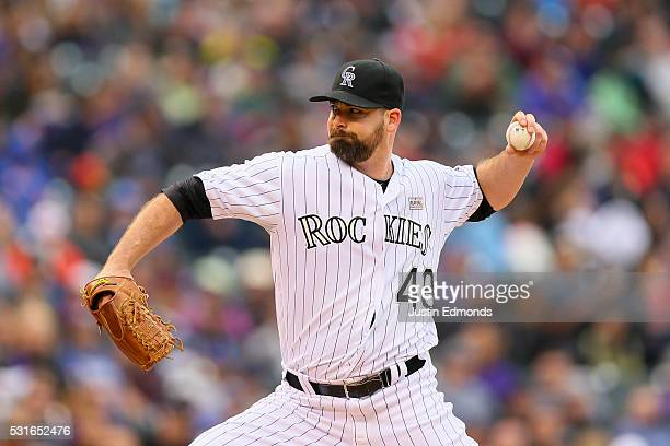 Relief pitcher Boone Logan of the Colorado Rockies delivers to home plate during the eighth inning against the New York Mets at Coors Field on May 15...