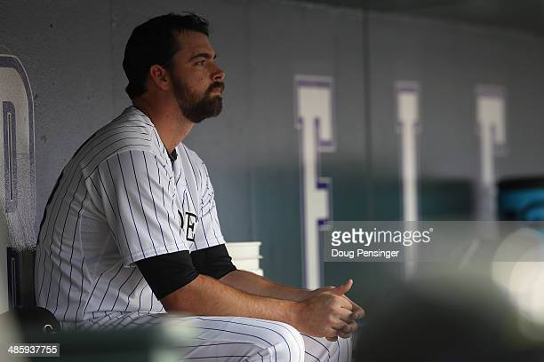 Relief pitcher Boone Logan of the Colorado Rockies looks on from the dugout after being removed from the game against the Philadelphia Phillies at...