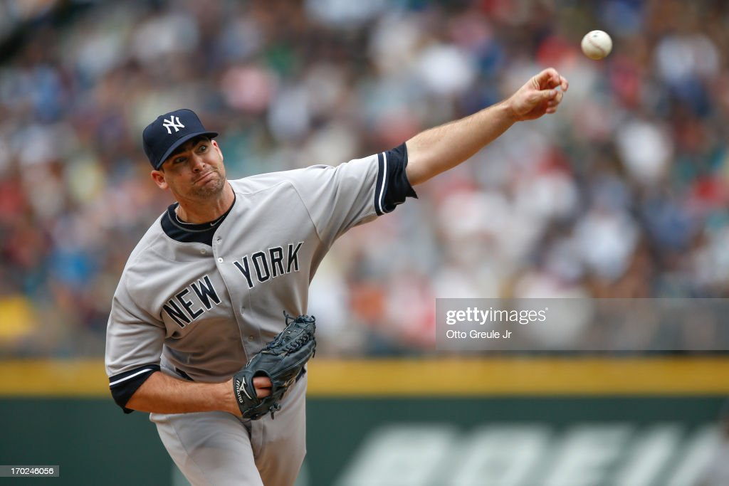 Relief pitcher <a gi-track='captionPersonalityLinkClicked' href=/galleries/search?phrase=Boone+Logan&family=editorial&specificpeople=640575 ng-click='$event.stopPropagation()'>Boone Logan</a> #48 of the New York Yankees pitches against the Seattle Mariners at Safeco Field on June 9, 2013 in Seattle, Washington.