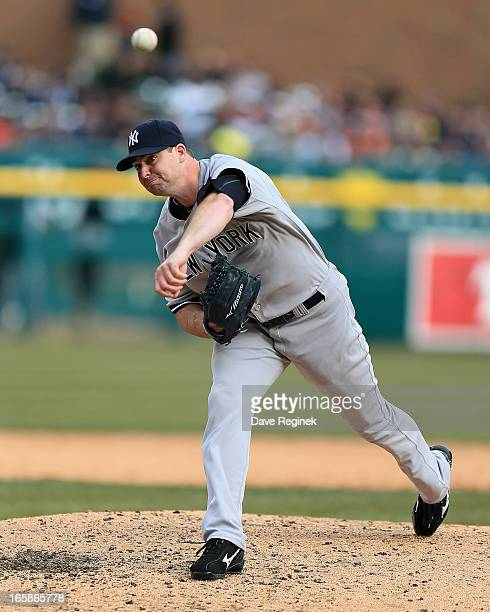 Relief pitcher Boone Logan of the New York Yankees throws the baseball in the fifth inning against the Detroit Tigers at Comerica Park on April 6...