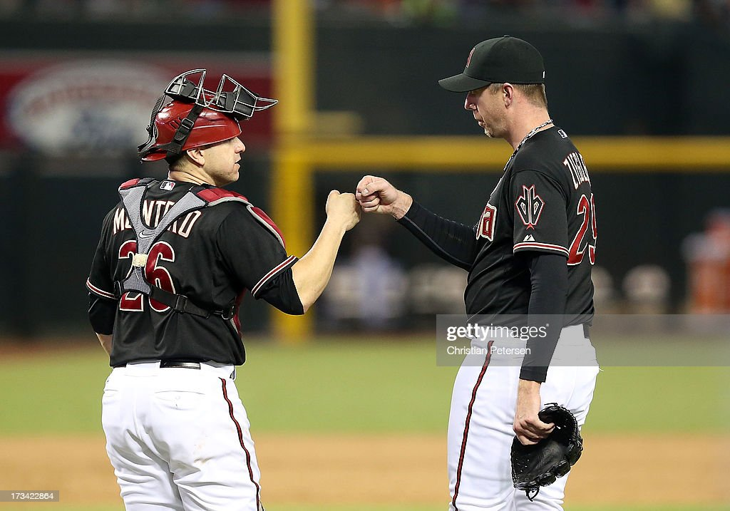 Relief pitcher <a gi-track='captionPersonalityLinkClicked' href=/galleries/search?phrase=Brad+Ziegler&family=editorial&specificpeople=4921772 ng-click='$event.stopPropagation()'>Brad Ziegler</a> #29 of the Arizona Diamondbacks celebrates with catcher <a gi-track='captionPersonalityLinkClicked' href=/galleries/search?phrase=Miguel+Montero&family=editorial&specificpeople=836495 ng-click='$event.stopPropagation()'>Miguel Montero</a> #26 after defeating the Milwaukee Brewers in the MLB game at Chase Field on July 13, 2013 in Phoenix, Arizona. The Diamondbacks defeated the Brewers 5-4.