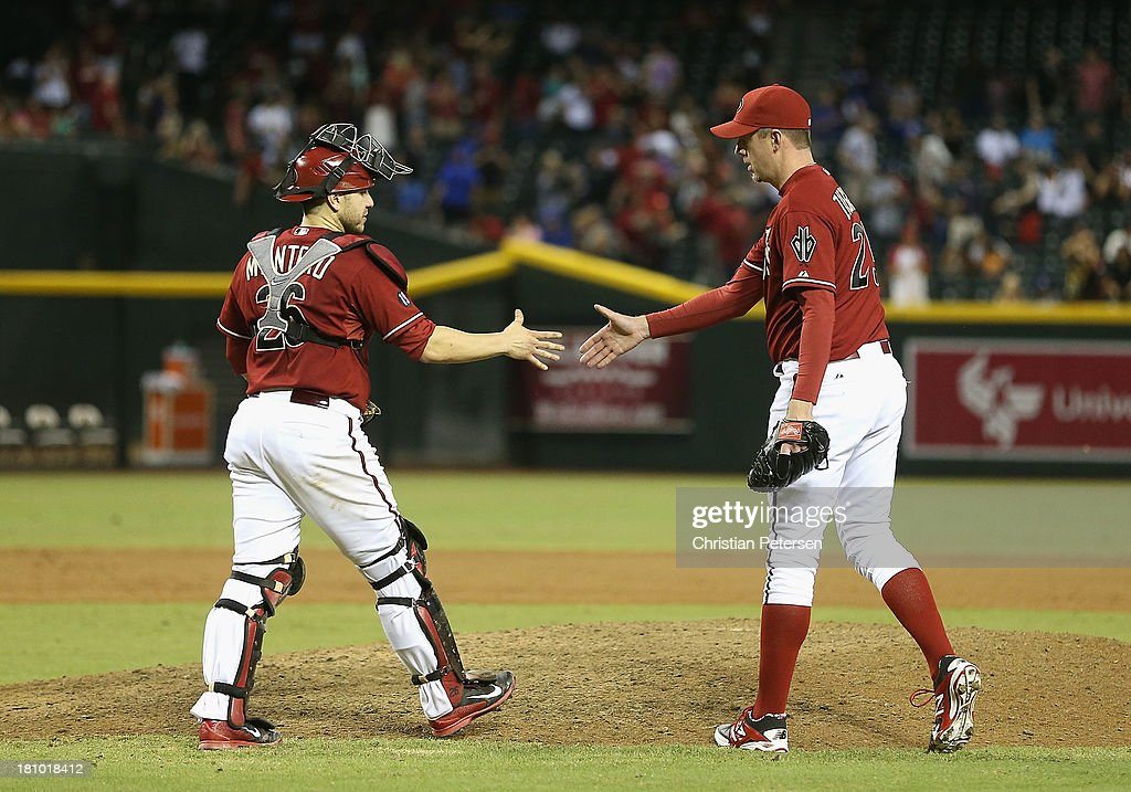 Relief pitcher <a gi-track='captionPersonalityLinkClicked' href=/galleries/search?phrase=Brad+Ziegler&family=editorial&specificpeople=4921772 ng-click='$event.stopPropagation()'>Brad Ziegler</a> #29 of the Arizona Diamondbacks celebrates with catcher <a gi-track='captionPersonalityLinkClicked' href=/galleries/search?phrase=Miguel+Montero&family=editorial&specificpeople=836495 ng-click='$event.stopPropagation()'>Miguel Montero</a> #26 after defeating the Los Angeles Dodgers at Chase Field on September 18, 2013 in Phoenix, Arizona. The Diamondbacks defeated the Dodgers 9-4.