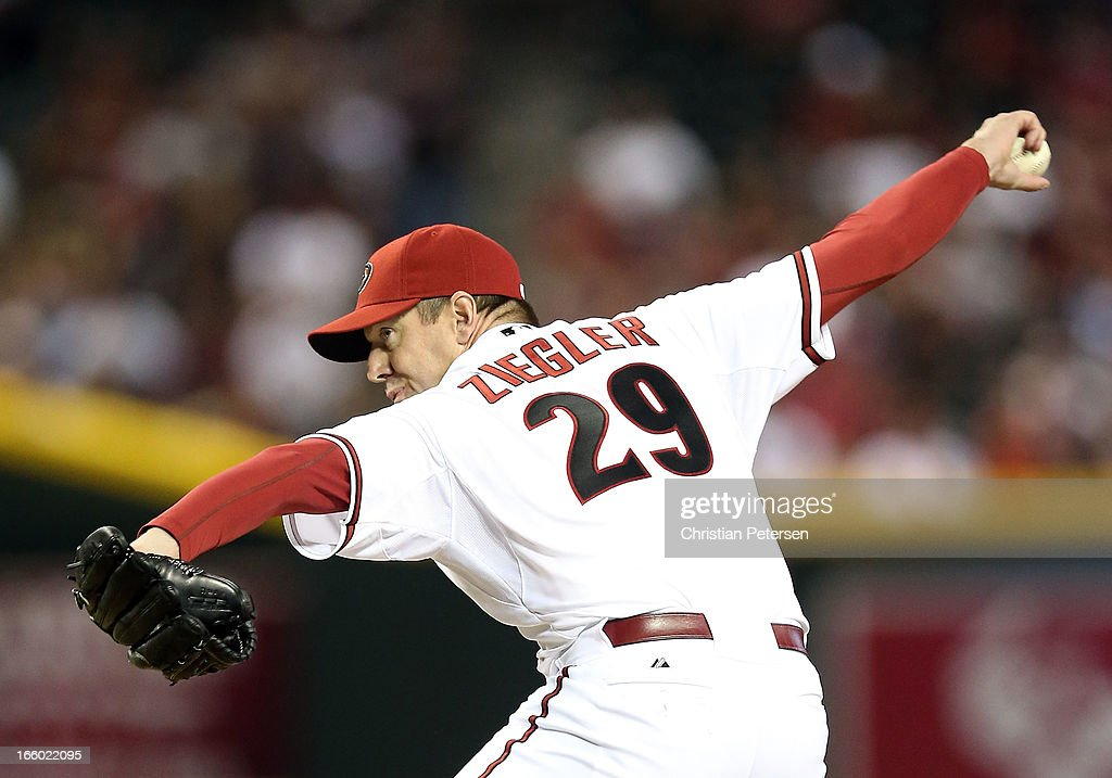 Relief pitcher <a gi-track='captionPersonalityLinkClicked' href=/galleries/search?phrase=Brad+Ziegler&family=editorial&specificpeople=4921772 ng-click='$event.stopPropagation()'>Brad Ziegler</a> #29 of the Arizona Diamondbacks pitches against the St. Louis Cardinals during the MLB Opening Day game at Chase Field on April 1, 2013 in Phoenix, Arizona. The Diamondbacks defeated the Cardinals 6-2.