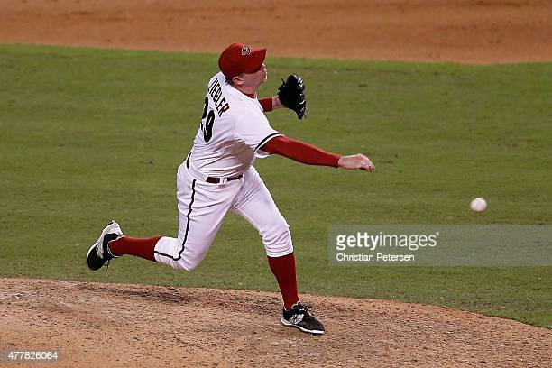 Relief pitcher Brad Ziegler of the Arizona Diamondbacks pitches against the San Diego Padres during the ninth inning of the MLB game at Chase Field...