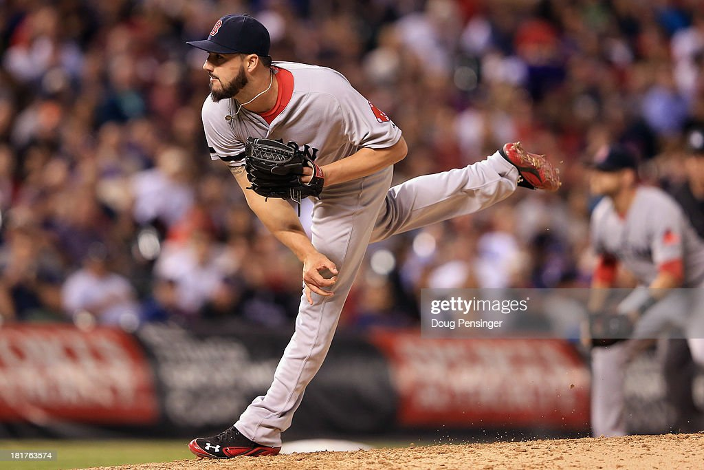 Relief pitcher Brandon Workman #67 of the Boston Red Sox delivers against the Colorado Rockies as he gave up three runs in the seventh inning at Coors Field on September 24, 2013 in Denver, Colorado. The Rockies defeated the Red Sox 8-3.