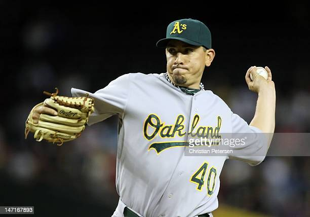Relief pitcher Brian Fuentes of the Oakland Athletics pitches against the Arizona Diamondbacks during the interleague MLB game at Chase Field on June...