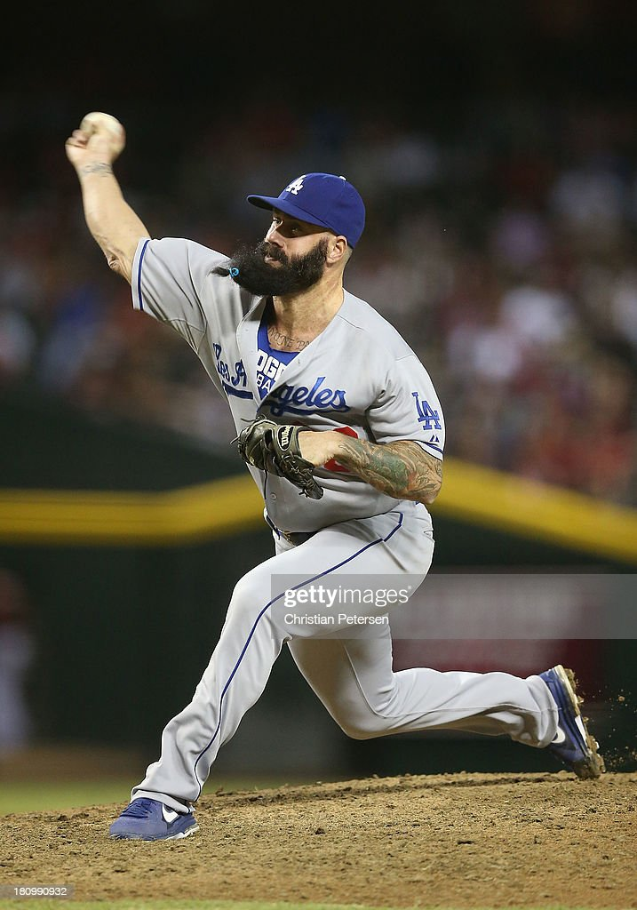 Relief pitcher Brian Wilson #00 of the Los Angeles Dodgers pitches against the Arizona Diamondbacks during the MLB game at Chase Field on September 18, 2013 in Phoenix, Arizona.